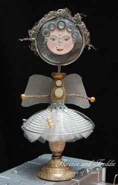 Art doll made from recycled items - old sieve, metal scourer and candle stick