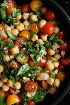 Chickpeas, basil, grape tomatoes, garlic, apple cider vinegar, white wine vinegar, salt, honey.  could add cucumbers too.