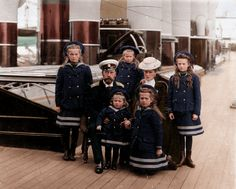 Coloured black and white photo of the Russian royal family on their yacht, the Polar Star. From left, clockwise, we have: Olga, Tsar Nicolas II, Anastasia, Tsarina Alexandra, Tatiana, Maria, and Alexei
