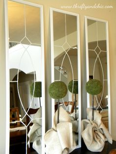 These beautiful decorative mirrors are inspired by Ballard designs and look so simple to make. Plus, they're super cheap...$5 each from Target and then you spruce 'em up a bit with paint.
