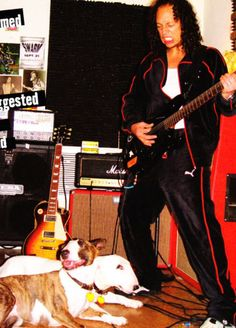 Kirk Hammett and his dogs- not sure of the look on his face though!
