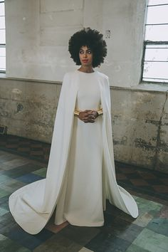 Solange Knowles wore a floor-length Humberto Leon for Kenzo gown with an attached cape for her Nov. 16 New Orleans wedding.