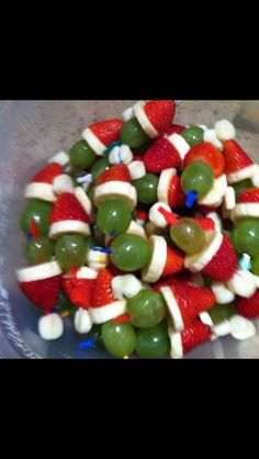 Santa grinch snacks. Making these for the twins Christmas party! A marshmallow, strawberry, banana slice, and green grape on a toothpick
