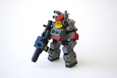 "Mechs built from Legos For the game; Mobile Frame Zero.  Red Unit ""Kingfisher""    [variant based on Soren's chub design] with a Bazooka.  Designed by: Ironsniper     Flickr page here: http://www.flickr.com/photos/ironweasel/6844651624/in/pool-438009@N25"