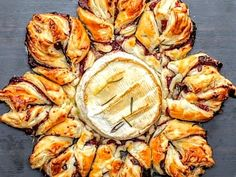 What You'll Need: 1 baking camembert 2 sheets puff pastry 3 tbsp cranberry sauce 1/3 cup crispy bacon bits 1 egg, whisked rosemary, a few leaves How You Make...