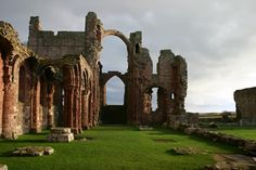 Lindisfarne Monastery. It is the first monastery to be raided by Vikings! Access by a paved causeway which is covered by the North Sea twice in every 24 hour period.