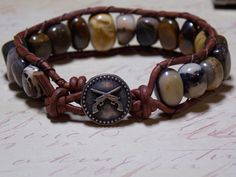 This Rustic Brown leather wrap bracelet has beautiful Jasper nuggets gemstones( 10 mm) in shades of tans/ brown/ greens/ black. The wrap bracelet has a metal button, double... #fashion #jewelry #bohemian #bracelets
