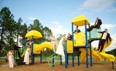 Wedding Party Photo on a playground! I wish I had thought of this for my wedding!