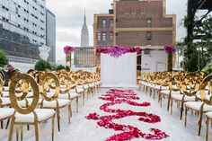 Inside Weddings Summer 2017 Issue Preview gold chairs rooftop wedding ceremony pink flowers