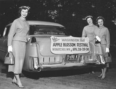 The 1955 Apple Blossom Festival royalty, Queen Sharon Kaye Redlinger and princesses Anna Lea Batterman and Judy Emerson, pose with their official festival vehicle, a pink Cadillac.