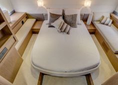 Beneteau Gran Turismo 44: This wide-angle view of the master stateroom shows the lounger at right, the bench seat at left and the recessed deck at the foot of the bed to maximize headroom.