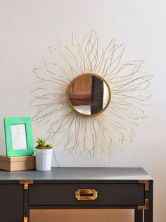 Look For Less: Anthropologie-Inspired Starburst Mirror : Get the look for less and create your own Anthropologie-inspired mirror using simple supplies like styrofoam and wire. Dollar Tree Mirrors, Dollar Store Mirror, Diy Wand, Gold Diy, Ideas Decorar Habitacion, Gold Sunburst Mirror, Funky Junk Interiors, Diy Inspiration, Art Mural