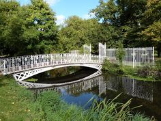 One of the delicate bridges over the river Wandle in Modern Hall Park.
