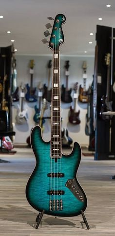 Mensinger Elwood Absolution bass. RESEARCH #cSw:) - https://www.pinterest.com/claxtonw/bass-foundation/ - BASS FOUNDATION, because gorgeous basses like this deserve full info: Public Peace of Aldenhoven, Germany presented as its Guitar of the Month in March 2013 this blue beauty by Mensinger Custom Guitars & Maruszczyk Instruments. Blueburst with dark binding and block inlays. Also available in orange & yellow fire colored Sunburst. More