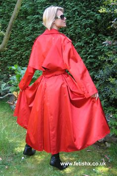 An absolutely gorgeous red rubberized mackintosh. So full and such a beautiful drape.