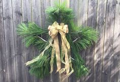 Make your front porch (or your fence) a star for Christmas. This easy-to-make wreath is crafted of yardsticks and fresh pine branches. You can even use Christmas tree cuttings. Learn more at The Home Depot Garden Club.