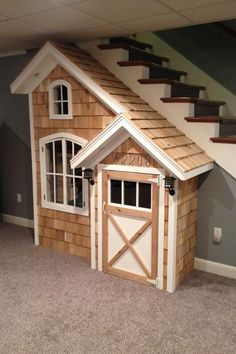 Make use of the space under your stairs by building an indoor playhouse for the kids - perfect for the rainy weather! Under Stairs Playhouse, Inside Playhouse, Kids Indoor Playhouse, Indoor Swing, Build A Playhouse, Outdoor Playhouses, Playhouse Ideas, Backyard Playhouse, Under Basement Stairs