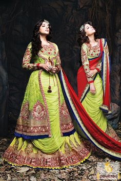 The gorgeous blue red and lime net georgette anarkali bridal salwar suit is beautified with heave and rich embroidery work,lace patti work and stone work.