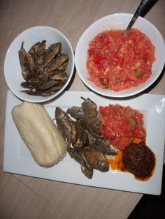 Ghanaian Dish - Kenkey with fish and pepper ...which is boiled fermented corn dough, fried fish and freshly ground tomatoes, pepper and onion sauce