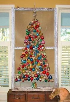 Unique idea--ornaments attached to an old screen window--love it!