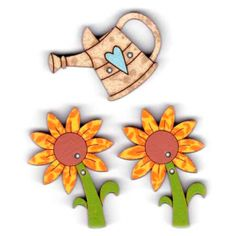 Botones decorativos de madera con forma de girasol y regadera.  Medida: 3.5 x 2.5 cm.