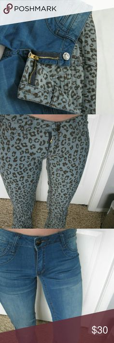 """Reversible Rock 47 jeans Reversible Rock 47 jeans. New condition, only been worn once. Super comfortable soft jeans. Inside is leopard print, outside is Normal blue jeans. Size 0x34. Love these jeans, just selling because 34"""" inseam is too long for me. Wrangler Jeans Boot Cut"""