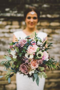 Gorgeous autumn or winter bridal bouquet by www.mrs-umbels.co.uk photography by Ed Godden