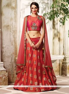 We unfurl our the intricacy and exclusivity of our creations highlighted in this style of a gorgeous red net and raw silk a line lehenga choli. The ethnic embroidered and patch border work at the atti...