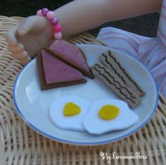 To create these doll sized breakfasts you will need:    ■Tan fun foam  ■White fun foam  ■Dark brown fun foam  ■A black marker  ■White glue  ■Red paint  ■Pink felt  ■Yellow felt