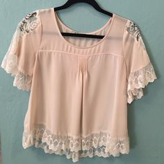 Feminine blouse Cream colored lace detailed top. Brand is lush, size small. This top is in great condition and adorable with jeans! Chloe K Tops Blouses