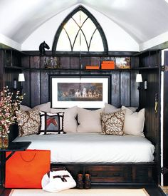Daybed with gothic window. Black, orange, and neutrals. Equestrian.