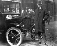 """Henry Ford with 1921 Model T. """"While other auto makers wanted to design luxury cars, Henry Ford designed a car that anyone could afford. Here he is standing by that very car. From the collections of The Henry Ford and Ford Motor Company. Ford Motor Company, Ford Company, Ford Mustang, Ford Raptor, Ford Explorer, Vintage Cars, Antique Cars, Vintage Racing, Vintage Black"""