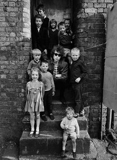 Looks like Bob Dylan isn't too thrilled to hang out with the kids at the orphanage.