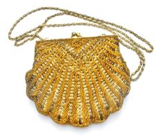 Vintage bead handbag - This is a heavily beaded clam shell clutch purse with a scalloped bottom. It was made by La Regale Ltd in the 1970's-1980's. This purse measures 6.25 inches by 5.5 inches and ha
