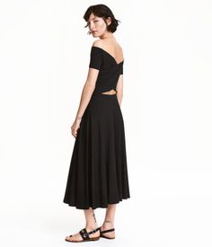 Calf-length, off-the-shoulder dress in jersey with short sleeves, wrapover back section, and elasticized seam at waist.