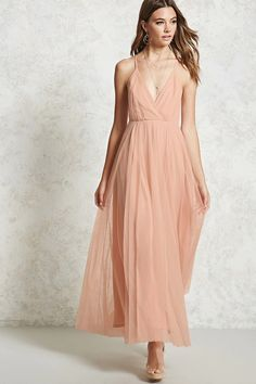 Forever 21 Contemporary - A woven gown featuring a tulle overlay, a surplice neckline, adjustable cami straps that cross in the back, a low back, and a hidden back zipper.