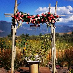 Coral and pink rose arch by Bride and Bloom Design Co