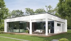 WeberHaus - Spacious and contemporary prefabricated bungalow with Bauhaus architecture Affordable Prefab Homes, Flat Roof House, Bauhaus Style, Bungalow Homes, Prefabricated Houses, Architect Design, Modern House Design, Continents, Sustainable Architecture
