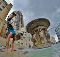 Handstands on Legacy Hotel Fountain in Sandton City Johannesburg