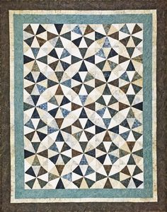 Stormy Bali Batik Roundabout Quilt - all pre-cut patchwork and borders come together in a neat kit! Precision cut by Jordan Fabrics in Grants Pass, Oregon.