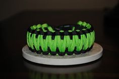 Got mine today!  Learned how to make it but it's nice to have someone make one for you!  550 Paracord Survival Bracelet King Cobra Weave Black/Lime Green
