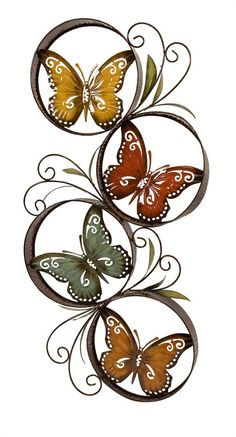 """Metal wall dacor detailing multiple encircled, colorful butterflies. Product Description • Product Dimensions: 26.25"""" H x 19.75"""" W • Product Re-Shipper Dimensions: 36.25"""" L x 11.5"""" W x 19"""" H • Product"""