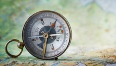 Magnetic compass on world map.Travel, geography, navigation, tourism and exploration concept background. Very shallow focus.