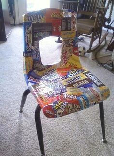 Decoupaged chair using plastic candy wrappers.
