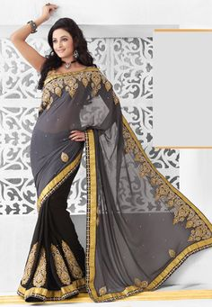 Grey and black faux georgette resham, zari and patch border work half half saree. As shown black art brocade blouse fabric is available and also can be customized from 36 to 42 inches as per your style or pattern subject to fabric limitation. (Slight variation in color and patch border is possible.) data-pin-do=