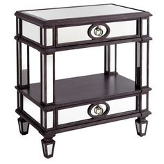This nightstand has all the traits of a neoclassically inspired beauty. Two mirrored drawers with an opening shelf provide premium storage space. Brushed nickel hardware adds a muted shine. And a natural wood finish creates a casual, but stylish piece of decor. Reflect on that.