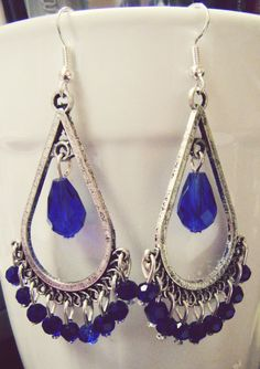 Blue Sapphire Swarovski Crystal Dangling Earrings. $6.00, via Etsy.