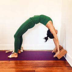 DETAIL + DEPTH | Here is an accessible way of taking Urdhva Dhanurasana 1. Place two blocks slanted against a wall, shoulder-width apart. Come to the back with the head between the blocks. The blocks reduce the flexibility (and strength) required to...