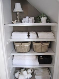43 Ideas How to Organize Your Bathroom. Painted back wall of closet = less boring!