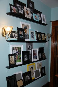My foyer picture frame display... had to add braces b/c of hollow plaster wall but painted them the same color as the wall to make them disappear (also spray painted old picture frames)